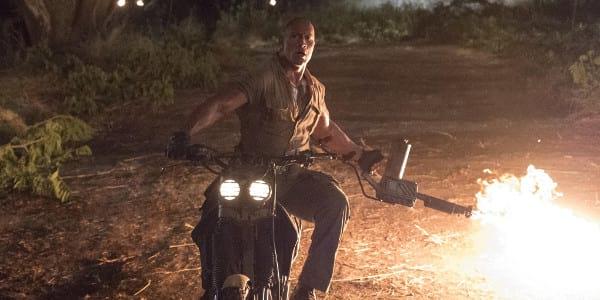 "Dwayne Johnson Smolders as a Video Game Action Hero in ""Jumanji"""