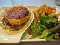 Roast chicken, leek and bacon pot pie with chips and green salad