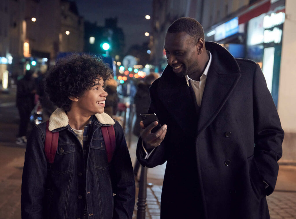 Raoul (Etan Simon) and his father Assane (Omar Sy) in Lupin